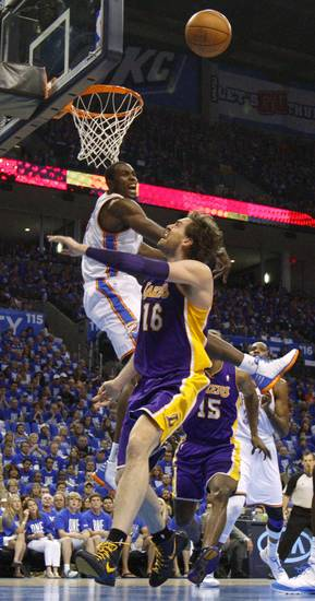 Oklahoma City's Serge Ibaka (9) blocks the shot of Los Angeles' Pau Gasol (16) during Game 1 in the second round of the NBA playoffs between the Oklahoma City Thunder and L.A. Lakers at Chesapeake Energy Arena in Oklahoma City, Monday, May 14, 2012. Photo by Bryan Terry, The Oklahoman