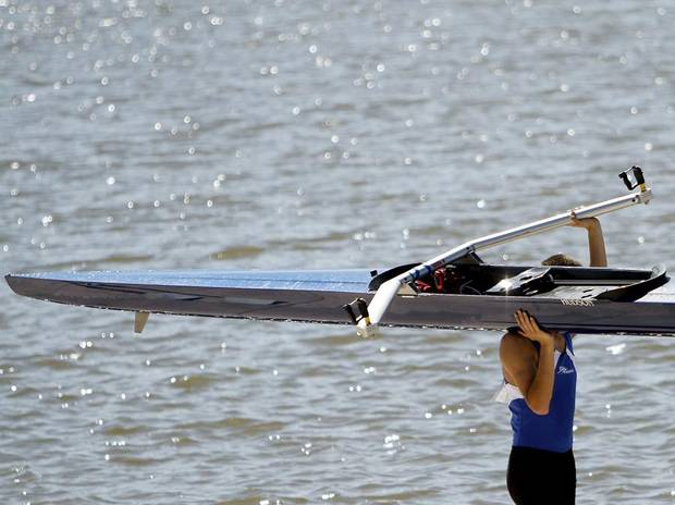 ROWERS / ROWING: A rower carries his boat toward the Devon Boathouse after the 2011 Head of the Oklahoma Regatta at the Oklahoma River in Oklahoma City on Sunday, October 2, 2011. Photo by John Clanton, The Oklahoman ORG XMIT: KOD