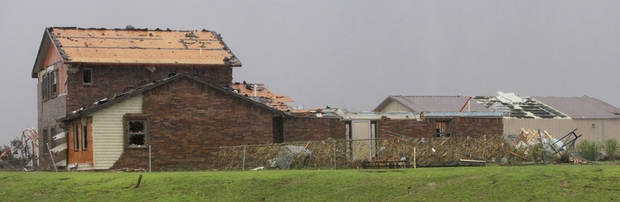 House and barn damage on the north side of SH 3 a couple miles west of SH 4 that was on the edge of the tornado that crossed SH 3 moving north towards Piedmont Tuesday, May 24, 2011. Photo by Paul B. Southerland, The Oklahoman ORG XMIT: KOD