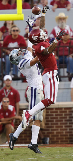 Oklahoma's Kenny Stills (4) has a pass broken up by Kansas State's Ty Zimmerman (12) during the college football game between the University of Oklahoma Sooners (OU) and the Kansas State University Wildcats (KSU) at the Gaylord Family-Memorial Stadium on Saturday, Sept. 22, 2012, in Norman, Okla. Photo by Chris Landsberger, The Oklahoman