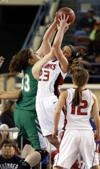 Adair's Anna Crawford fouls Bailee Eldred (23) on a rebound during the 3A girls semifinal game between the Adair High School Lady Warriors and the Sulphur Lady Bulldogs at the State Fair Arena on Friday, March 8, 2013 in Oklahoma City, Okla.  Photo by Steve Sisney, The Oklahoman