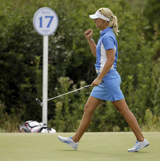 Europe's Anna Nordqvist, from Sweden, reacts after winning the 17th hole to tie United States' Stacy Lewis in their singles match at the Solheim Cup golf tournament on Sunday, Aug. 18, 2013, in Parker, Colo. (AP Photo/Chris Carlson)