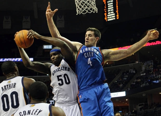 Grizzlies forward Zach Randolph (50) pulls down a rebound in front of Thunder center Nick Collison (4) on Tuesday. AP photo