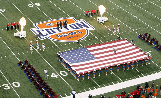The American flag is presented before the Cotton Bowl Classic college football game between the Oklahoma State University Cowboys (OSU) and the Ole Miss Rebels at Cowboys Stadium in Arlington, Texas, Saturday, January 2, 2010. Photo by Sarah Phipps, The Oklahoman