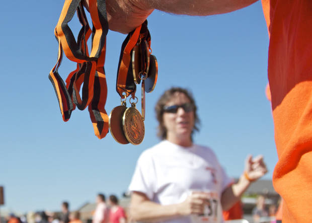 Medals were handed out to all participants of the Remember the Ten run was held in Stillwater, Okla on April 21, 2012. Photos by Mitchell Alcala for the Oklahoman  ORG XMIT: KOD