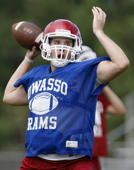 Quarterback Kason Key runs drills during a spring football practice at Owasso High School on Wednesday, May 25, 2011. MATT BARNARD/Tulsa World