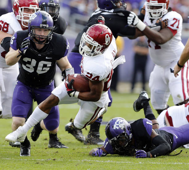 Oklahoma&#039;s Brennan Clay (24) runs during the college football game between the University of Oklahoma Sooners (OU) and the Texas Christian University Horned Frogs (TCU) at Amon G. Carter Stadium in Fort Worth, Texas, on Saturday, Dec. 1, 2012. Photo by Steve Sisney, The Oklahoman