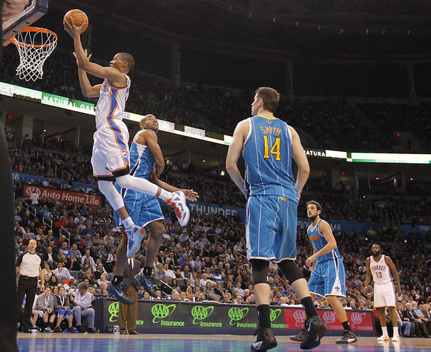 Oklahoma City Thunder point guard Russell Westbrook (0) drives to the basket past New Orleans Hornets point guard Jarrett Jack (2) during the NBA basketball game between the Oklahoma City Thunder and the New Orleans Hornets at the Chesapeake Energy Arena on Wednesday, Jan. 25, 2012, in Oklahoma City, Okla. Photo by Chris Landsberger, The Oklahoman
