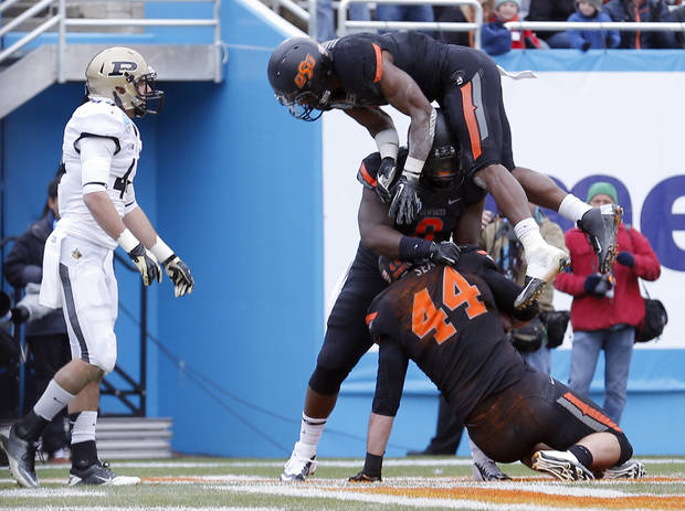 Oklahoma State celebrates a touchdown during the Heart of Dallas Bowl football game between the Oklahoma State University (OSU) and Purdue University at the Cotton Bowl in Dallas,  Tuesday,Jan. 1, 2013. Photo by Sarah Phipps, The Oklahoman