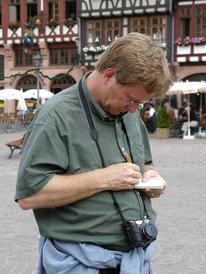 Rick Steves takes a break to jot down some notes before continuing his European journey. Steves spends more than 100 days a year traveling to Europe and other places in the world.  PHOTO PROVIDED. <strong></strong>