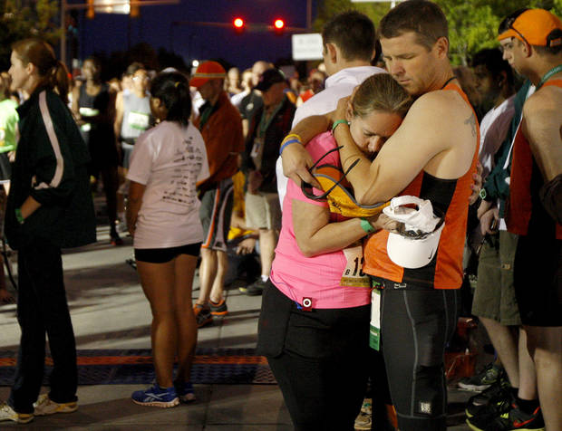 Bret and Angie Sholar embrace during 168 seconds of silence before the Oklahoma City Memorial Marathon in Oklahoma City, Sunday, April 29, 2012. Photo by Bryan Terry, The Oklahoman