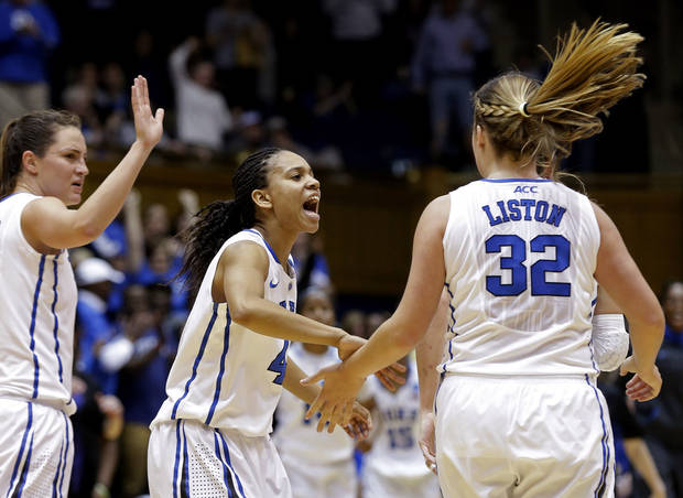 From left, Duke's Haley Peters, Chloe Wells and Tricia Liston (32) react late in the second half of a second-round game against Oklahoma State in the women's NCAA college basketball tournament in Durham, N.C., Tuesday, March 26, 2013.  Duke won 68-59. (AP Photo/Gerry Broome)