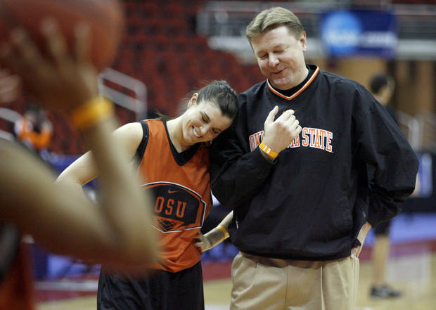 OSU's Taylor Hardeman and head coach Kurt Budke laugh during practice at Wells Fargo Arena in Des Moines, Iowa, Friday, March 21, 2008. Oklahoma State University will play East Tennesse State University in a first round game of the women's NCAA basketball tournament on Saturday. BY BRYAN TERRY, THE OKLAHOMAN
