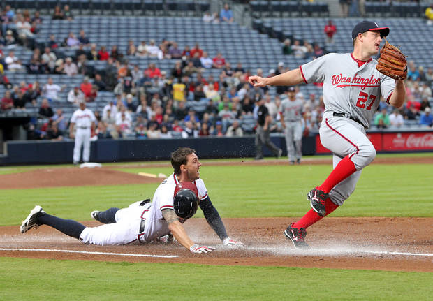 Washington Nationals pitcher Jordan Zimmermann wins the foot race to first base covering the bag for the out on a ground ball by Atlanta Braves' Jordan Schafer during the first inning of a baseball game Wednesday, May 1, 2013, in Atlanta. (AP Photo/Atlanta Journal Constitution, Curtis Compton) GWINNETT OUT  MARIETTA OUT