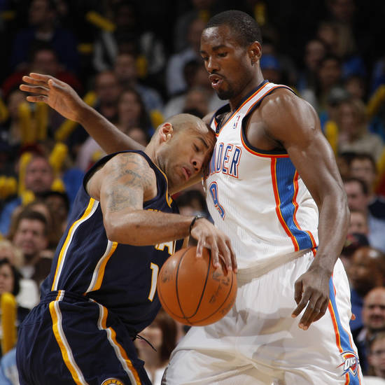 Oklahoma City's Serge Ibaka (9) defends Indiana's Dahntay Jones (1) during the NBA basketball game between the Oklahoma City Thunder and the Indiana Pacers at the Oklahoma City Arena, Wednesday, March 2, 2011. Photo by Bryan Terry, The Oklahoman