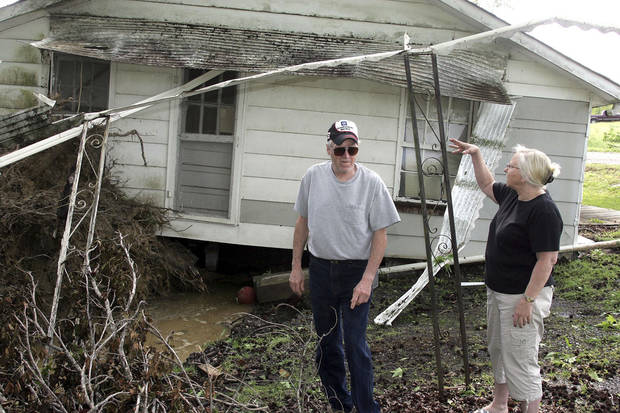 "Johnny Denney and his sister Patsy Dyson check the storm damage to the family home place  near Arab, Ala., after a storm early Wednesday,   April 27, 2011. A wave of thunderstorms with near hurricane-force winds pushed across Alabama on Wednesday, killing at least five people including a woman in a mobile home and sending snapped tree limbs onto cars and homes. The widespread destruction caused Gov. Robert Bentley to declare a state of emergency by midday, saying tornadoes, severe thunderstorms, hail, and straight-line winds caused damage to ""numerous homes and businesses"" in Alabama.   (AP Photo/The Huntsville Times, Robin Conn)"