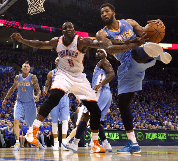 Oklahoma City's Kendrick Perkins (5) fights for the ball with Denver's Wilson Chandler (21) during the NBA basketball game between the Denver Nuggets and the Oklahoma City Thunder in the first round of the NBA playoffs at the Oklahoma City Arena, Sunday, April 17, 2011. Photo by Bryan Terry, The Oklahoman