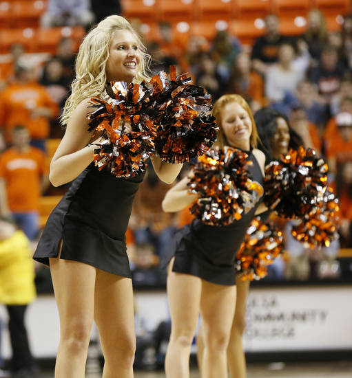 The OSU pom squad dances during a men's college basketball between Oklahoma State University and Missouri State at Gallagher-Iba Arena in Stillwater, Okla., Saturday, Dec. 8, 2012. OSU won, 62-42. Photo by Nate Billings, The Oklahoman