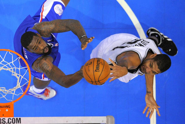 San Antonio Spurs forward Tim Duncan, right, shoots as Los Angeles Clippers center DeAndre Jordan defends during the first half of their NBA basketball game, Wednesday, Nov. 7, 2012, in Los Angeles. (AP Photo/Mark J. Terrill)