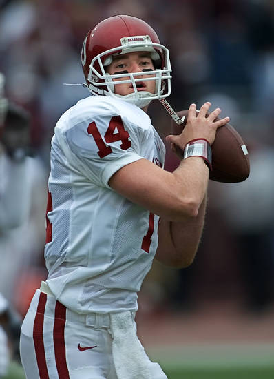 Oklahoma quarterback Josh Heupel warms up before his team's 35-31 win at Texas A&M on Nov. 11, 2000. PHOTO BY STEVE SISNEY, THE OKLAHOMAN ARCHIVE