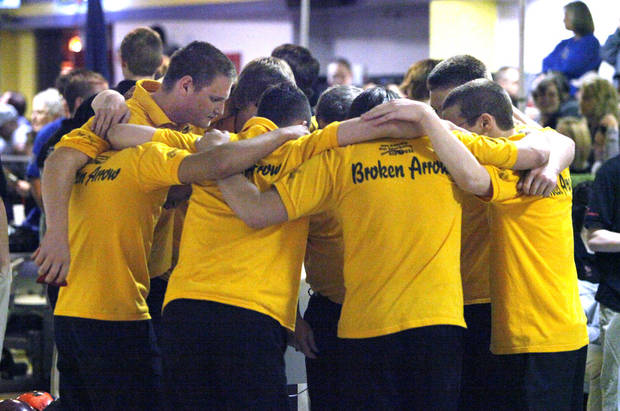 The Broken Arrow team gets motivated before beginning the 2011-2012 State High School Bowling Championships at the Heritage Lanes Bowling Center in Oklahoma City, OK, Saturday, Feb. 25, 2012. By Paul Hellstern, The Oklahoman