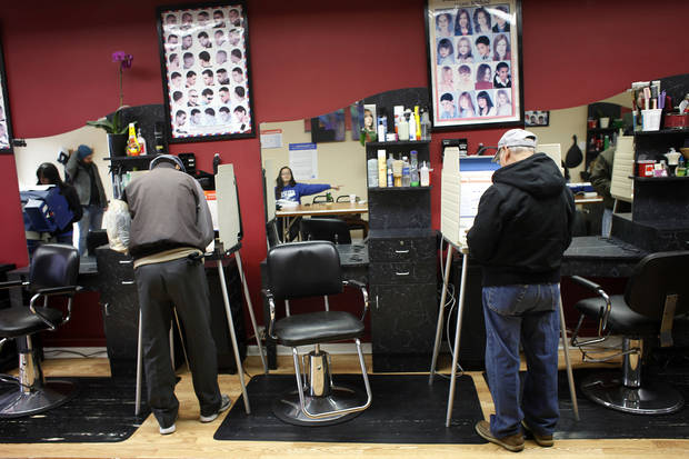 Voters cast their ballots in Delias beauty salon turned polling place, on election day on the South Side of Chicago, Tuesday Nov. 6, 2012. (AP Photo/Jerome Delay)