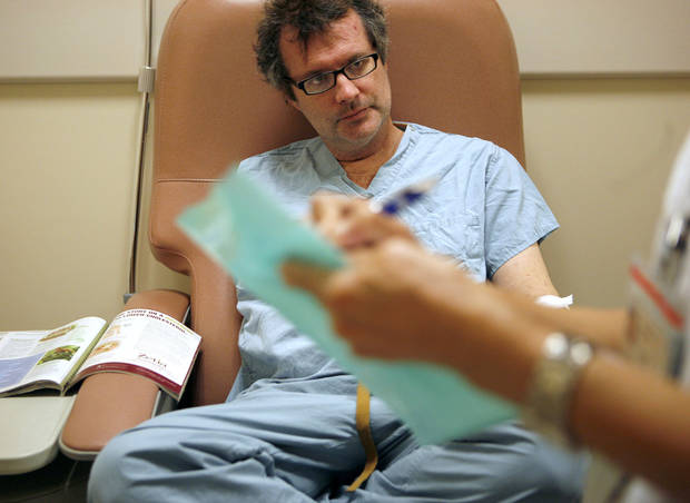 Jim talks with a nurse during a visit to MD Anderson&#039;s Cancer Clinic in Houston, Tx., on Tuesday Jan. 20, 2009. Jim spent two days at MD Anderson Cancer Clinic. The first day, Jim had several tests, the second day he and Leann got the results. By John Clanton, The Oklahoman