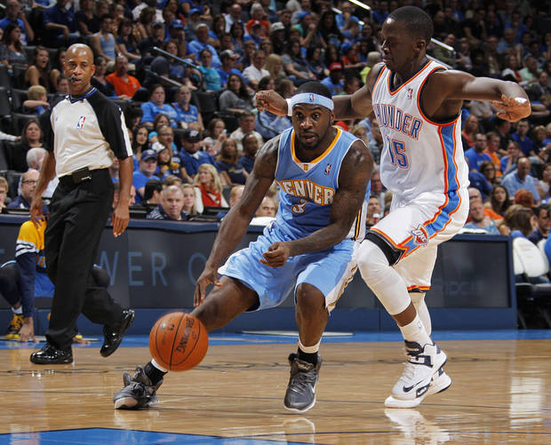 Oklahoma City's Reggie Jackson (15) blocks Denver's Ty Lawson (3) during the NBA preseason basketball game between the Oklahoma City Thunder and the Denver Nuggets at the Chesapeake Energy Arena, Sunday, Oct. 21, 2012. Photo by Garett Fisbeck, The Oklahoman