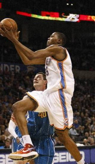 Oklahoma City Thunder's  Kevin  Durant, front, goes in front of New Orleans Hornets Ryan Bowen, back, to the basket in the fourth quarter of an NBA basketball game in Oklahoma City, Tuesday, Feb. 17, 2009. New Orleans won 100-98. (AP Photo/Alonzo Adams)