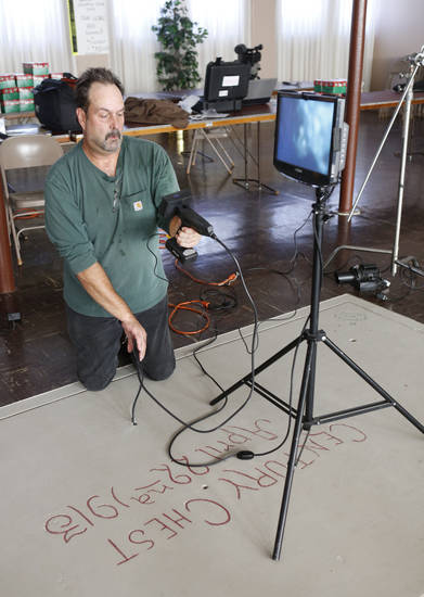 Videographer Andy Slaucitajs uses an borescope camera to look inside the vault-like structure that houses the First Lutheran Church Century Chest at First Lutheran Church of Oklahoma City, 1300 N Robinson. Photo by Steve Gooch, The Oklahoman <strong>Steve Gooch - The Oklahoman</strong>