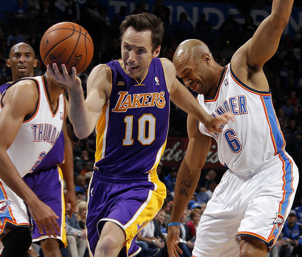 Los Angeles' Steve Nash (10) tries to get past Oklahoma City's Derek Fisher (6) during an NBA basketball game between the Oklahoma City Thunder and the Los Angeles Lakers at Chesapeake Energy Arena in Oklahoma City, Tuesday, March. 5, 2013. Photo by Bryan Terry, The Oklahoman
