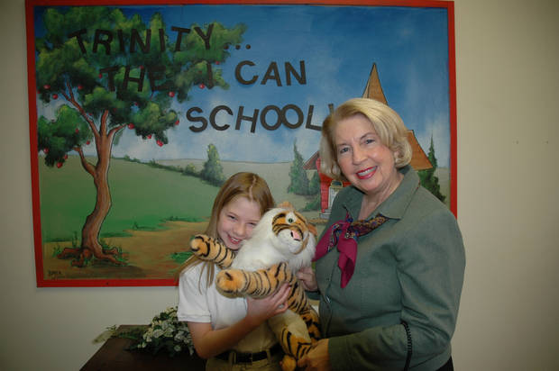 Trinity Head of School Darlene Troxel, of El Reno, presents the school mascot to a student<br/><b>Community Photo By:</b> Kelly Feroli<br/><b>Submitted By:</b> Kelly, Oklahoma City