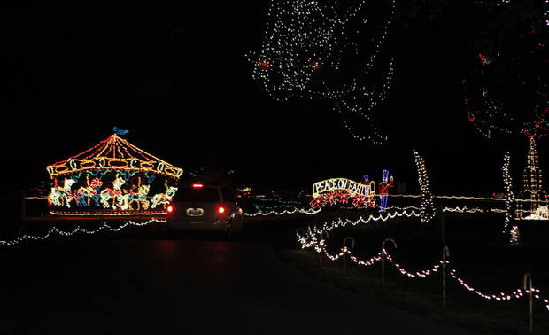 Cars drive through Joe B. Barnes Regional Park during the opening ceremony of the Midwest City Holiday Lights Spectacular. Photo by Garett Fisbeck, The Oklahoman <strong>GARETT FISBECK - GARETT FISBECK</strong>
