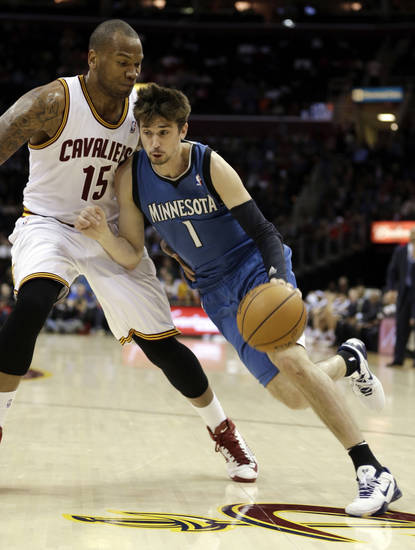 Minnesota Timberwolves' Alexey Shved (1), from Russia, drives past Cleveland Cavalier's Marreese Speights (15) during the second quarter of an NBA basketball game Monday, Feb. 11, 2013, in Cleveland. (AP Photo/Tony Dejak)
