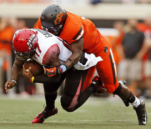 OSU&#039;s Daytawion Lowe (8) sacks ULL quarterback Blaine Gautier (17) in the first quarter during a college football game between Oklahoma State University and the University of Louisiana-Lafayette at Boone Pickens Stadium in Stillwater, Okla., Saturday, Sept. 15, 2012. Photo by Nate Billings, The Oklahoman