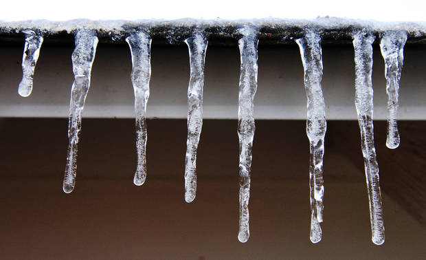 Icicles hanging off a roof in northwest Oklahoma City Friday afternoon, Nov. 22, 2013.  Photo by Paul B. Southerland, The
