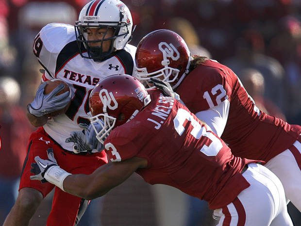 Oklahoma's Jonathan Nelson (3) and Austin Box (12) stop Texas Tech's Lyle Leong (19) during the first half of the college football game between the University of Oklahoma Sooners (OU) and the Texas Tech Red Raiders (TTU) at the Gaylord Family-Oklahoma Memorial Stadium on Saturday, Nov. 13, 2010, in Norman, Okla.  Photo by Chris Landsberger, The Oklahoman