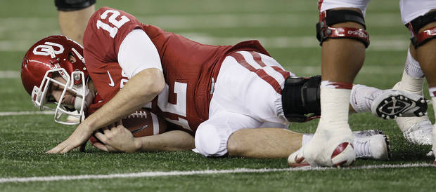 Oklahoma&#039;s Landry Jones (12) hits the turf after a sack during the college football Cotton Bowl game between the University of Oklahoma Sooners (OU) and Texas A&amp;M University Aggies (TXAM) at Cowboy&#039;s Stadium on Friday Jan. 4, 2013, in Arlington, Tx. Photo by Chris Landsberger, The Oklahoman