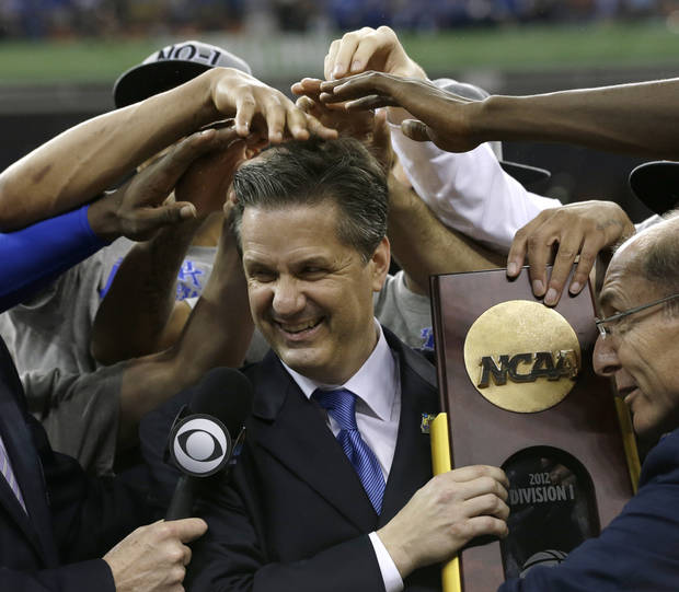 Kentucky head coach John Calipari, center, celebrates with his team after the NCAA Final Four tournament college basketball championship game against Kansas Monday, April 2, 2012, in New Orleans. Kentucky won 67-59. (AP Photo/David J. Phillip)