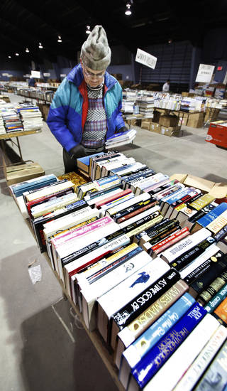 Larry Eberhardt, Okla. City, sorting books on tables Tuesday, Feb. 16, 2010, for the annual Friends of the Library book sale this weekend in Oklahoma City. Photo by Paul B. Southerland, The Oklahoman