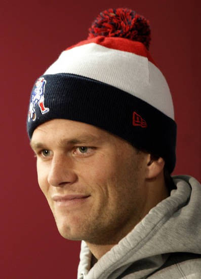 New England Patriots quarterback Tom Brady listens to a reporter's question during a media availability at the NFL football team's facility in Foxborough, Mass., Wednesday, Dec. 5, 2012. (AP Photo/Stephan Savoia)