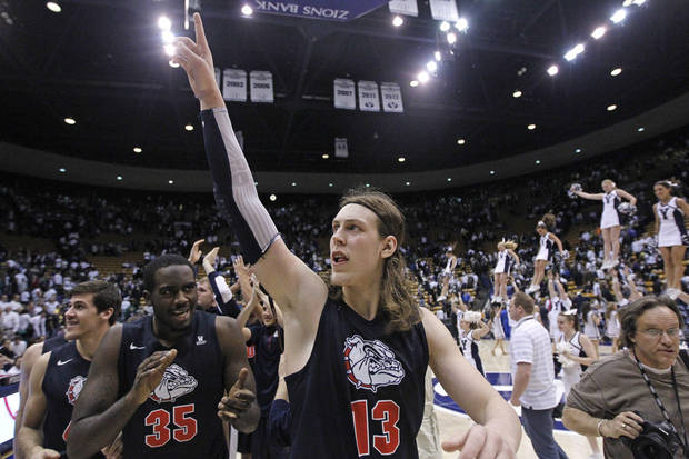 Gonzaga's Kelly Olynyk (13) and teammate Sam Dower (35) celebrate their 70-65 victory over Brigham Young during their NCAA basketball college game Thursday, Feb. 28, 2013, in Provo, Utah.  (AP Photo/Rick Bowmer) ORG XMIT: UTRB113