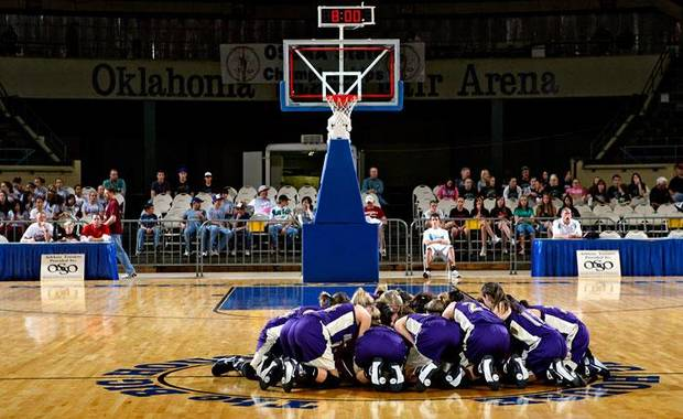The Okarche girls huddle up at center court before the semifinals of the Class A girls Oklahoma State Basketball Championships against Crowder at the State Fair Arena on Friday, March 6, 2009, in Oklahoma City, Okla.  PHOTO BY CHRIS LANDSBERGER, THE OKLAHOMAN