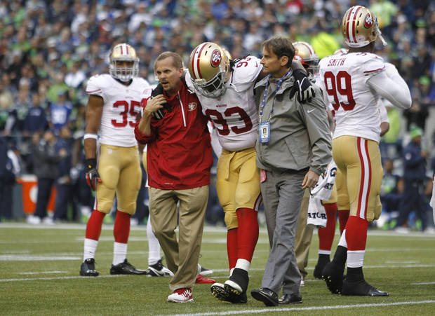 San Francisco 49ers' Ian Williams (93) is taken off the field with an injury in the first half of an NFL football game against the Seattle Seahawks, Sunday, Sept. 15, 2013, in Seattle. (AP Photo/John Froschauer)
