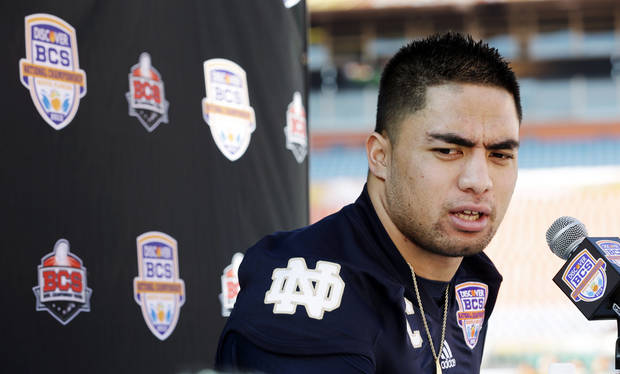 FILE - In this Jan. 5, 2013, file photo, Notre Dame linebacker Manti Te'o answers a question during media day for the BCS national championship NCAA college football game in Miami. The wrenching story of Te'o's girlfriend dying of leukemia _ a loss he said inspired him to play his best all the way to the BCS championship _ was dismissed by the school Wednesday, Jan. 16, as a hoax perpetrated against the linebacker. (AP Photo/David J. Phillip, File) ORG XMIT: NY166