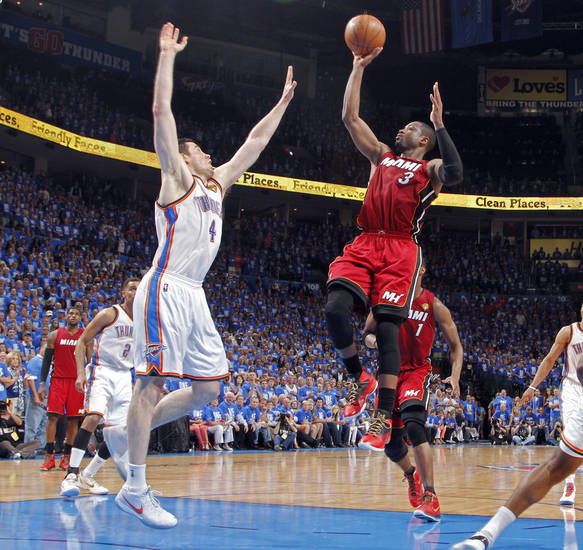 Miami's Dwyane Wade (3) shoots over Oklahoma City's Nick Collison (4) during Game 1 of the NBA Finals between the Oklahoma City Thunder and the Miami Heat at Chesapeake Energy Arena in Oklahoma City, Tuesday, June 12, 2012. Photo by Chris Landsberger, The Oklahoman