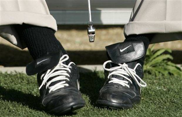 The shoes and whistle belonging to Penn State coach Joe Paterno are seen as he sits before practice for the Rose Bowl Game in Carson, Calif., Saturday, Dec. 27, 2008. Penn State plays Southern California in the Rose Bowl NCAA college football game on New Year's Day in Pasadena, Calif. (AP Photo/Danny Moloshok)