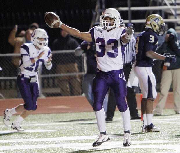 Bethany&#039;s Devin Campbell (33) celebrates after scoring a two-point conversion in the second quarter during the Class 3A high school football semifinal playoff  game between Heritage Hall and Bethany at Putnam City High School in Oklahoma City, Saturday, December 4, 2010. Photo by Nate Billings, The Oklahoman