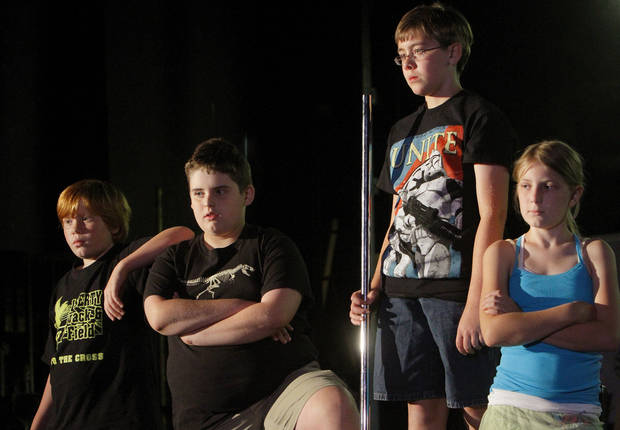 Rehearsing on stage, from left, are Aaron Ellis, Braydon Buzzard, Liam Larson and Anna Cook, who took part in the summer arts program.