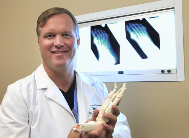 Dr. Scott Morris discuses how a bunion is removed. Photo by David McDaniel, The Oklahoman